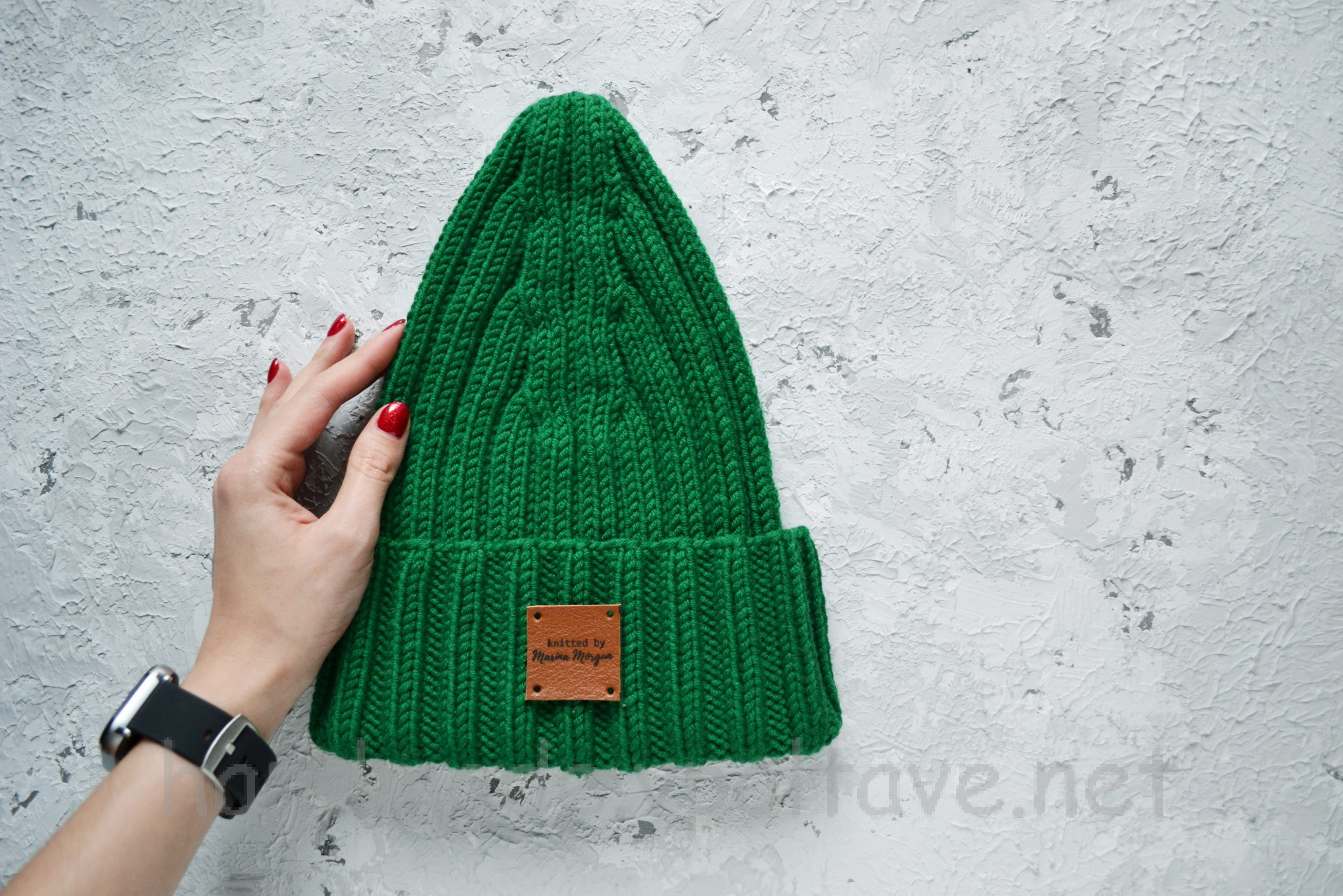 women's hat with knitting needles